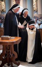 After making her First Profession the sister exchanges her white veil for a black one, symbolic of conversion, penance, and consecration to God.