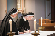 """The words """"for all my life"""" in the profession formula take on a profound significance as the sister promises to live in poverty, chastity and obedience, according to the Rule of St. Augustine and the Constitutions of the Dominican Sisters of St. Cecilia, until death."""